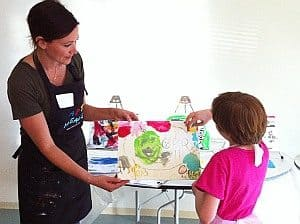 Girl Painting with Instructor